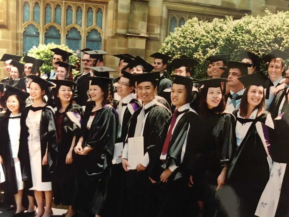 Human, People, Person, Graduation, Clothing, Coat, Overcoat, Suit, Tuxedo, Classroom